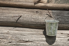 Bucket and wooden wall Royalty Free Stock Photography