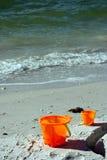 Buckets on a beach royalty free stock photo