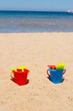 Buckets on the beach Stock Images