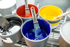 Buckets with CMYK paints Royalty Free Stock Images