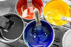 Buckets with CMYK paints Royalty Free Stock Photo