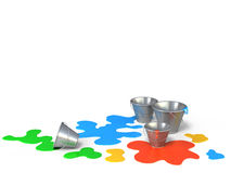 Buckets with different colors paint on a white background. Stock Photos