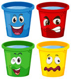 Buckets with faces Stock Images