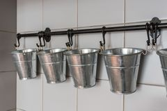 Buckets in the kitchen for the organization of spices and decorations. Royalty Free Stock Photography