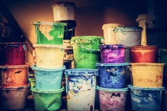 Buckets of liquid paint standing in a workshop. Royalty Free Stock Photos