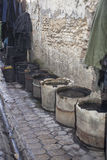 Buckets near a tannery Stock Photo