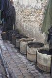 Buckets near a tannery Stock Photo