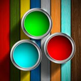 Buckets of paint on the wooden floor Royalty Free Stock Images