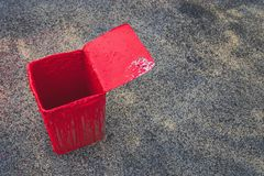 Buckets of red paint used on the road. stock photo