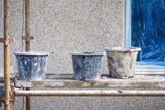 Buckets on scaffold Stock Photography