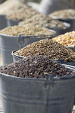 Buckets of seeds wheat in focus. Buckets of seeds on the agricultural market Stock Images