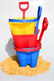 Buckets and Spades. A holiday image of buckets and spades with sand from a beach stock images