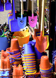 Buckets and spades. A selection of brightly coloured buckes and spades on sale in a shop Royalty Free Stock Images