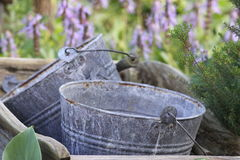 Buckets in a Wheel Barrow Stock Images