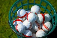 Buckett of golf balls. Medium shot of a buckett of golf balls Royalty Free Stock Photo