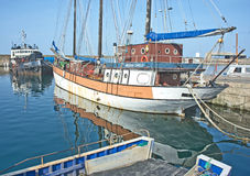 Buckie harbor. On the North East Coast of Scotland which also has boat building and repair yards and is on the  tourist route. Regina Caelis is a tall ship in Royalty Free Stock Images
