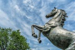 Bucking steel horse. On a nice cloudy sky Stock Photo