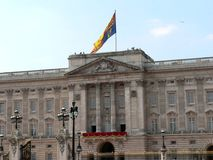 Buckingham Palace. With flag stock photography