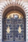 Buckingham Palace, decorative metal golden gate to the courtyard, London, United Kingdom Royalty Free Stock Photo