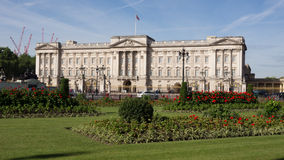 Buckingham palace. With flower beds in the foreground Royalty Free Stock Photo