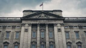 Buckingham Palace Front With Flag Blowing. Front view of Buckingham Palace with union jack flag stock footage