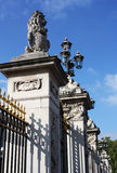 Buckingham Palace gate. Statue and lamps on the gate of famous Buckingham Palace in London Stock Images