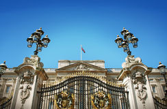 Buckingham Palace Gate and British Flag Stock Photo