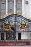 Buckingham palace gate with crest Royalty Free Stock Image