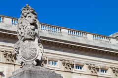 Buckingham Palace gate - Lion. Statue and lamps on the gate of famous Buckingham Palace in London Stock Image