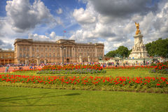 Buckingham Palace, London. Buckingham Palace in Spring. Flowers and beautyful sky Stock Photos