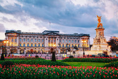 Buckingham palace in London, Great Britain. LONDON - APRIL 12: Buckingham palace at sunset on April 12, 2015 in London, UK. It's the London residence and Stock Photo