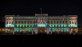 Buckingham Palace in London at night Royalty Free Stock Photo