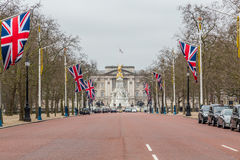 Buckingham Palace and the Mall in London. LONDON, UK - 9TH MARCH 2015: A view along the Mall towards Buckingham Palace during the day in the spring. Union Jack Stock Photo