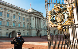 The Buckingham Palace and police officer on duty, England UK. Royalty Free Stock Images