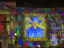 Buckingham Palace projection of Queen's portrait a Stock Photos
