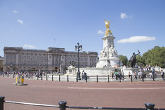 Buckingham palace with Queen victoria memorial and golden angel. LONDON, UK - AUG 12, 2016. Buckingham palace with Queen victoria memorial and golden angel Stock Image