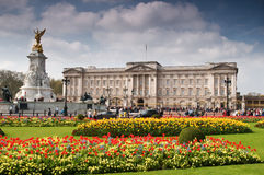 Buckingham Palace in Spring. Panoramic picture of Buckingham Palace with crowed of visitors in spring time Royalty Free Stock Photography