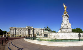 Buckingham Palace in summer. Victoria Memorial and Buckingham Palace London, home to the Queen of England. Clear deep blue summer sky Stock Images