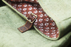Buckle bag accessories. Buckle handmade bag accessories closeup pattern cotton cloth Royalty Free Stock Photos