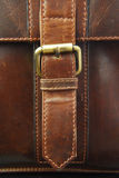 Buckle on leather briefcase Stock Photos