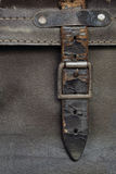 Buckle and Leather Strap on Vintage Suitcase. Old buckle and leather strap on vintage suitcase royalty free stock images