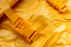 Buckle in a life jacket. Life, jacket, vest, safety, yellow, water, rescue, clothing, background, object, color, equipment, security, wear, safe, protective royalty free stock photos