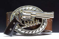Buckle made of metal carved into the gun. the gun. Stock Photography