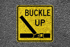 Buckle up On The Asphalt. Buckle up sign on the asphalt Stock Photos