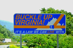 Buckle up Virginia. ! sign on the road in Virginia, It's a law we can live with Royalty Free Stock Photo