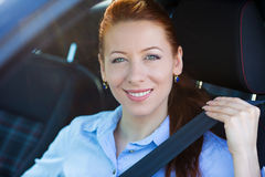 Buckle up. Woman inside black car follows traffic rules stock photography