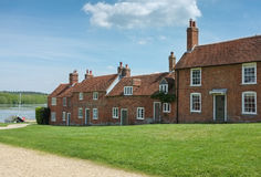 Buckler's Hard Cottages, Hampshire, England. Popular tourist attraction of Buckler's Hard in Hampshire, England.  A maritime village near Beaulieu.  Bucklers Royalty Free Stock Image