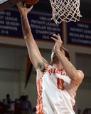 Bucknell's  #0 D.J. MacLeay lays the ball in Royalty Free Stock Image