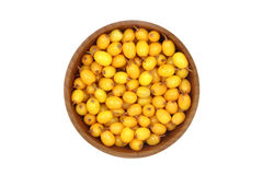 Buckthorn berries in a wooden bowl Royalty Free Stock Photography