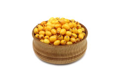 Buckthorn berries in a wooden bowl Stock Photography